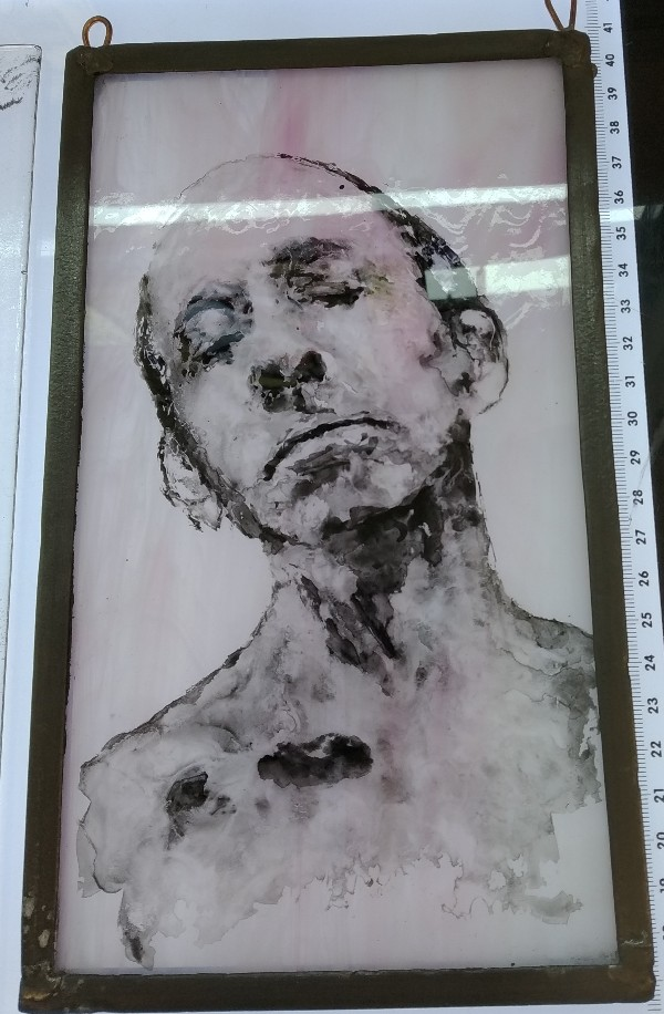 face image on stained glass