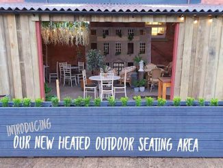 The Hop Barn outdoor cafe area at the Malthouse Collective in Stroud