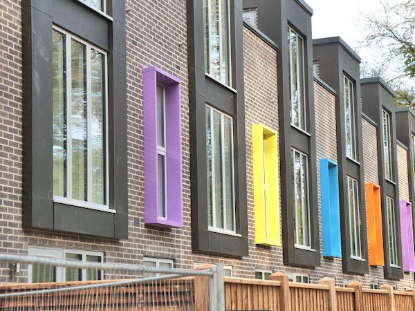 multi-coloured window frames at Rooksmoor Mills development